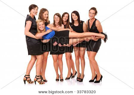 A portrait of seven girlfriends celebrating bachelorette party over white background