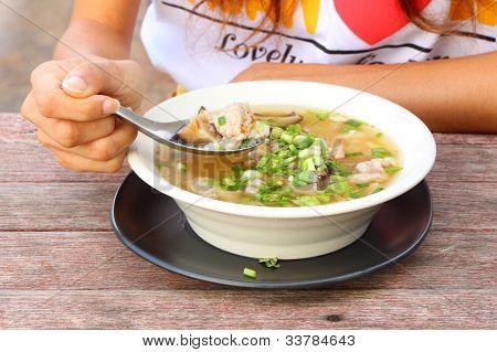 Pork and mushroom congee with dip hand.
