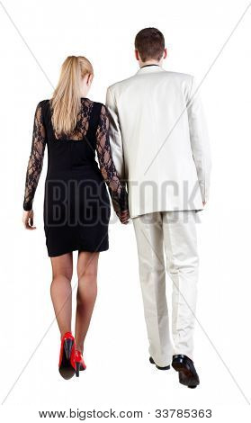 Back view of walking  young business team  (man and woman). going  beautiful girl in dress and guy in suit. Rear view people collection. backside view of person. Isolated over white background