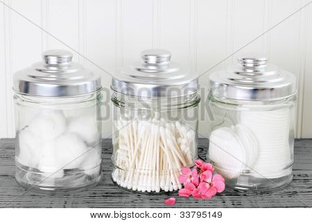 Containers of cotton health care supplies.