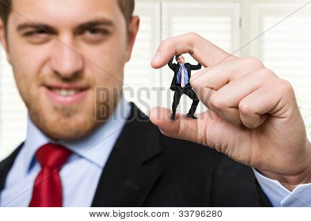 Big businessman crushing a small one