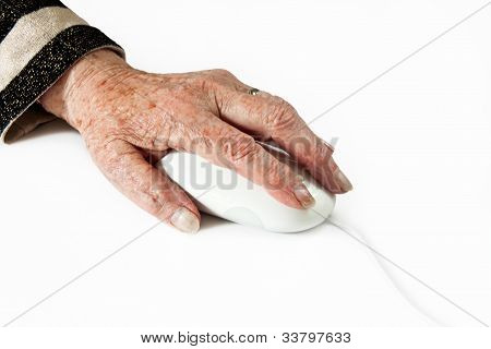Elderly Hand On Computer Mouse