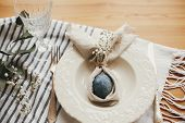 Stylish Easter Brunch Table Setting With Egg In Easter Bunny Napkin On  Table. Modern Natural Dyed B poster