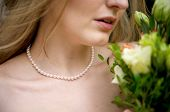 Close Up Of Bride'S Neckline And Flowers poster