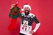 Each Surprise Is Just That. Surprised Hipster Hold Reindeer Toy. Bearded Man Prepare Surprise Gift.  poster