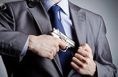 Businessman man with hand gun