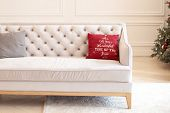 Pillow With Christmas Decoration On A Beige Sofa In Interior Of Room. Modern Minimalist Living Room  poster