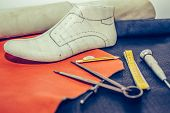 Cobbler Workplace With Tools, Leather And Shoes poster