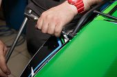 Master Sets The Trunk On The Rear Fender Of The Motorcycle. Replacing The Trunk Of A Motorcycle. poster