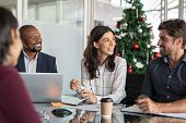Group of happy business people in meeting during christmas holiday. Smiling businessman and business poster