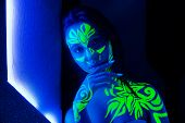 Body Art On The Body And Hand Of A Girl Glowing In The Ultraviolet Light. poster