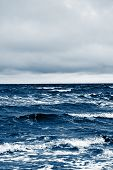 Classic Blue Sea Beach. North Sea. Stormy Weather: Strong Waves, Gloomy Sky, Sea Foam. Classic Blue  poster