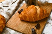 French Chocolate Croissants Top View. The Beginning Of The Morning. Fresh French Croissant. Coffee C poster