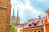 View Of Two Towers With Spires Of Cathedral Of St. John The Baptist Catholic Church And Tiled Roofs  poster