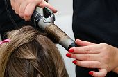 Stylist Making A Hairdo With Hair Curler. Beauty Salon Concept. poster