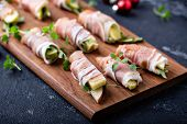 Christmas Or New Year Party Appetizer, Prosciutto Wrapped Apples And Cheese poster