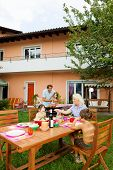 picture of nic  - Family having a barbecue in the garden - JPG
