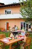 foto of nic  - Family having a barbecue in the garden - JPG
