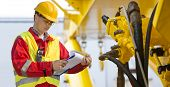 stock photo of hydraulics  - Hydraulic engineer doing a safety check on a new installation - JPG