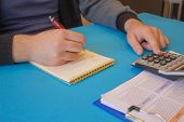Hands Of Accountant With Calculator And Pen. Accounting Background. Man Using A Calculator To Calcul poster