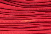 Clothes Stacked Close-up, Fabric Texture, Bright Colors, Neat Red Stacks poster