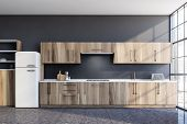 Stylish Gray Kitchen With Counters And Fridge poster