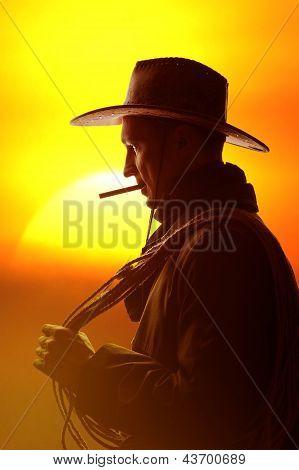 Vaqueiro em silhueta de chapéu