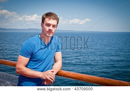 The Young Man On The Deck Against The Sea