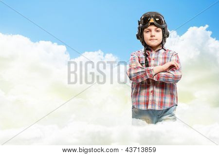 Boy in helmet pilot dreaming of becoming a pilot