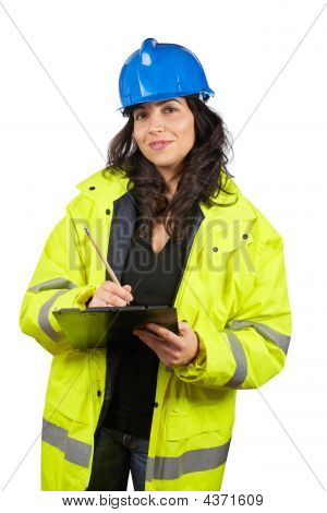 Female Construction Worker Writing