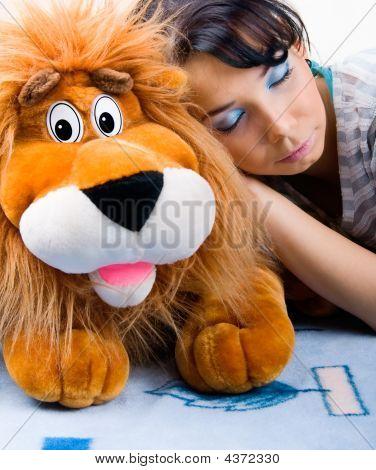 Beautiful Sleeping Girl With Her Plush Lion