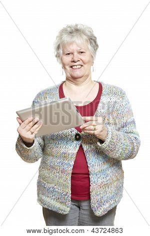 Senior Woman Using Tablet Computer Smiling