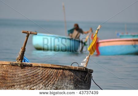 Vietnamese fisher fishing in Mui Ne, Vietnam