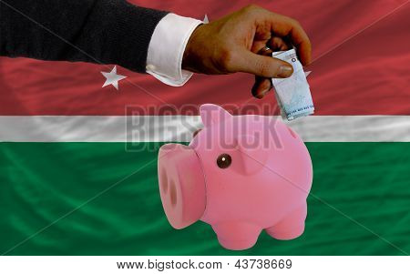 Funding Euro Into Piggy Rich Bank National Flag Of  Of Maghreb