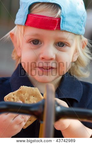 Cute Blond Boy With Cookie