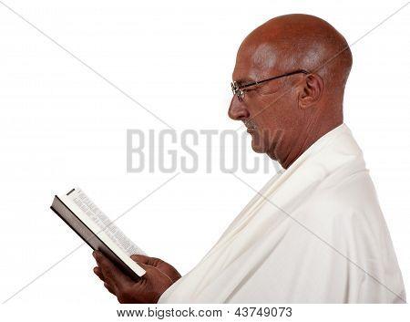 Senior Man Reads Book
