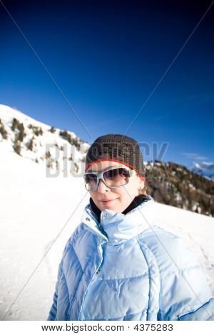 Young Woman Under The Sunlight In Alps Mountains