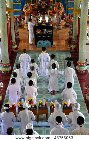 Religious ceremony in a Cao Dai temple, My Tho, Vietnam