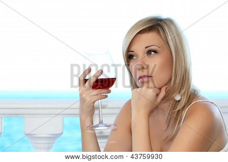 Close-up Portrait Of A Beautiful Girl In The Cafe With A Glass Of Red Wine A Chil