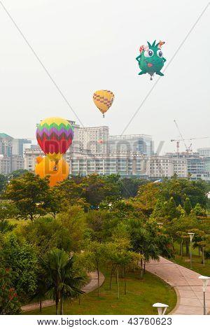PUTRAJAYA, MALAYSIA - MARCH 2013 - Various shapes of hot air balloons take off at the annual Hot Air