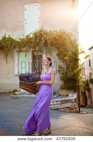 Girl With A Basket Of Freshly Cut Lavender In The Old City