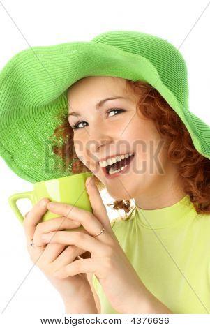 Cheerful Girl Drinking Tea