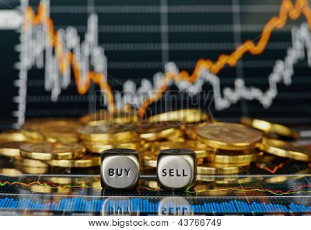 Dices Cubes With The Words Sell Buy And The Golden Coins. Financial Chart As Background. Selective F