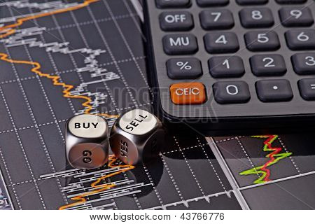 Dices Cubes With Words Sell Buy For Trader And Calculator. Financial Chart As Background. Selective