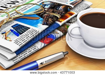 Newspapers and coffee on office table