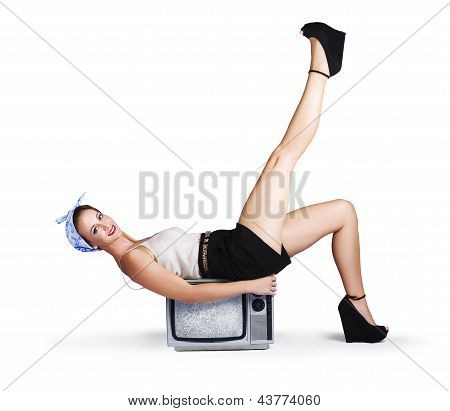 Pinup Girl Balancing On Television Set