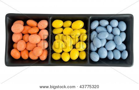 Bright Chocolate Covered Peanuts In Bowl, Isolated Over White