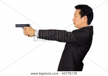 Asian Male Shooting A Gun On White