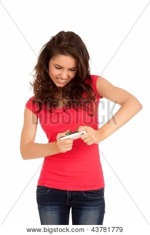 Excited woman playing games on smartphone