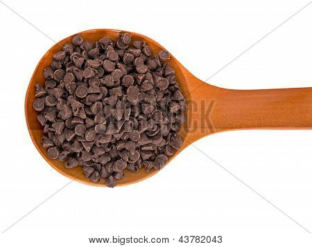 Choc Chips For Baking On Wooden Spoon, Isolated Over White Background